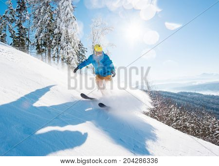 Shot Of A Professional Skier Skiing In The Mountains On Fresh Powder Snow On A Beautiful Sunny Winte
