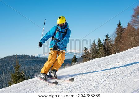Man Skier Riding The Slope On A Beautiful Sunny Winter Day On The Winter Resort