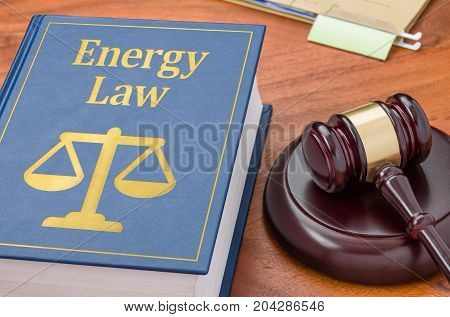 A law book with a gavel - Energy law