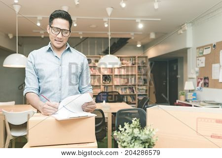 Young Asian Entrepreneur Checking Document At Home Office. Conceptual For Startup Small Businesses S