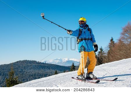 Shot Of A Professional Skier Taking A Selfie Using Selfie Stick Posing On The Slope Copyspace Recrea