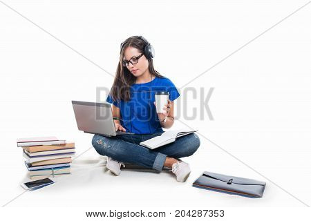 Student Girl Sitting Listening Music On Headphones While Studding
