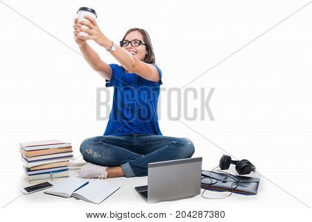 Student Girl Holding Coffee Around Books And Telephone
