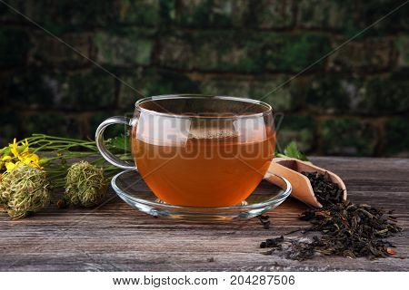 A Cup Of Tea With Tea Leaves. Tea Among The Herbs.