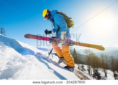 Male Skier Walking Up The Snowy Hill In The Carpathians Mountains Carrying His Skis Copyspace Season