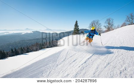 Professional Skier Riding The Slope On A Beautiful Winter Day Ski Resort Recreation Travelling Touri