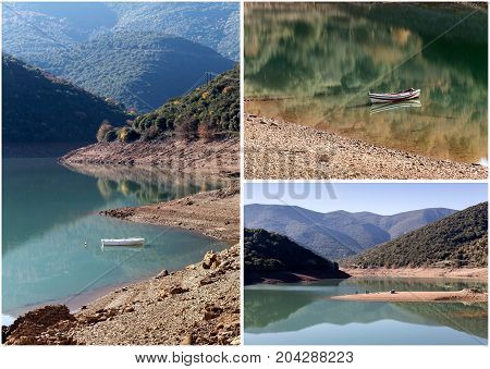 The panoramic view of mountain lake, boat and mountains