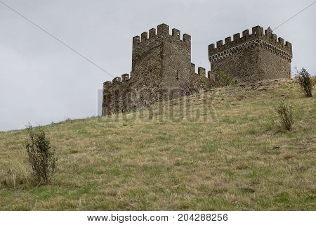 Ancient fortress towers against the background of the autumn sky. Architecture exterior