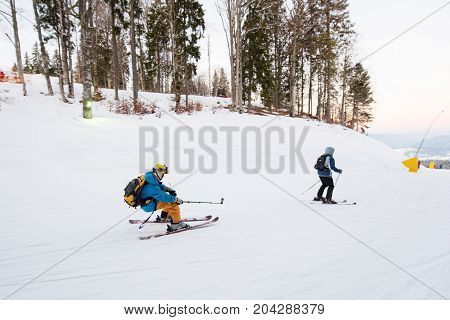 Skier Man Moving Down On Snow Powder And Relieves Himself On The Video With The Help Of A Stick Self