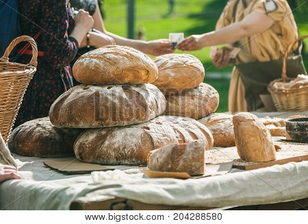 People Buying Bread At Outdoors Summer Exhibition. Trading Concept