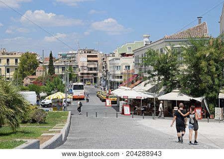 ATHENS GREECE - AUGUST 4 2016: People on a hot summer day in the city of Athens Greece.