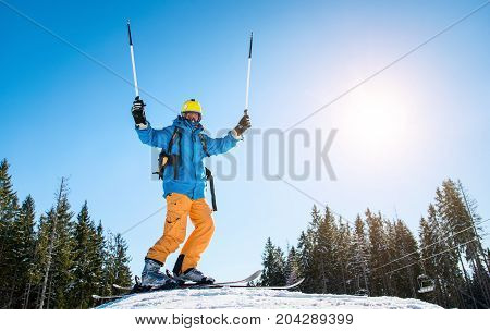 Low Angle Shot Of A Skier On Top Of A Slope Enjoying Skiing In The Mountains On A Sunny Beautiful Wi