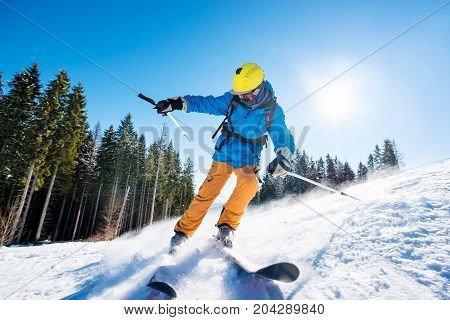 Shot Of A Professional Skier Skiing In The Mountains On Fresh Powder Snow At Winter Resort Equipment
