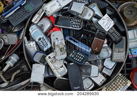 ATHENS GREECE - AUGUST 4 2016: Old mobile cell phones. Pile of broken handphones for sale at junk shop.