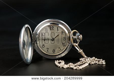 pocket watch on black background, old watch, mechanical watch