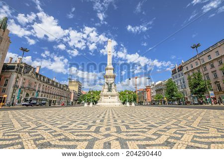Lisbon, Portugal - August 26, 2017: a popular Obelisk in Praca dos Restauradores or Restoration Square in honor of Portuguese Independence from Spain in Lisbon downtown. Sunny day, blue sky.