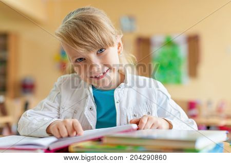 Young studying pupil smiling caucasian class portrait