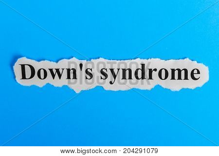 Down syndrome text on paper. Word Down syndrome on a piece of paper. Concept Image. Down syndrome Syndrome