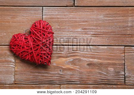 Love Heart On A Brown Wooden Background
