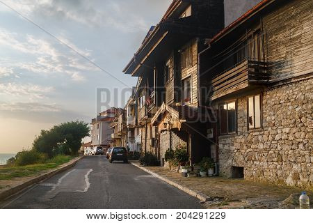 Nesebar Bulgaria - September 05 2014: Seaside resort and ancient old town Nesebar in Bulgaria. Bulgarian Black Sea Coast. Street ancient architecture and road. Architectural and historic complex. UNESCO world heritage site.
