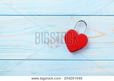 Heart Shaped Padlock On Blue Wooden Table