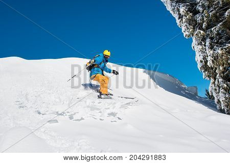 Male Freerider Skier Riding Downhill The Slope In The Mountains Copyspace Powder Snow Movement Motio