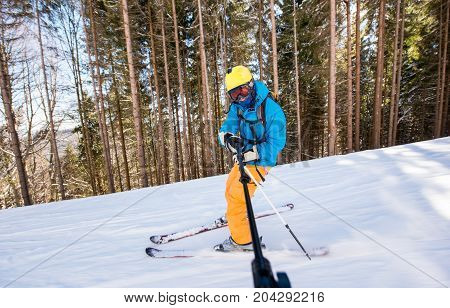 Male Skier Taking Selfie Picture Using Selfie Stick While Skiing Down The Slope The In The Mountains
