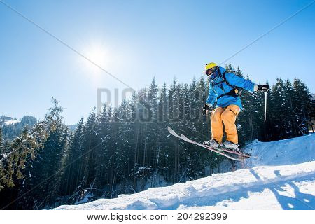 Professional Skier Jumping In The Air While Skiing In The Mountains Blue Sky On The Background Copys