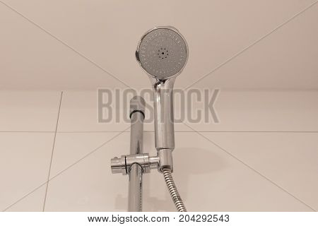 Shower Head On A Tiled Wall