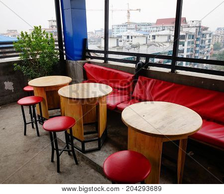 Chairs And Tables At Coffee Shop