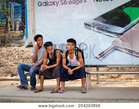 Young Men At Bus Station In Yangon, Myanmar