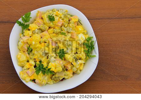 Russian Traditional Salad Olivier On Wooden Table