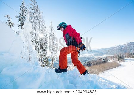 Snowboarder Carrying His Board Walking In The Winter Mountains On Sunny Day Copyspace Active Sports