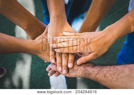 Businessman and working person coordinate hands. Concept Teamwork in business