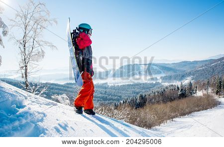 Full Length Shot Of A Snowboarder Freerider Standing On Top Of A Slope Looking Around Enjoying The V