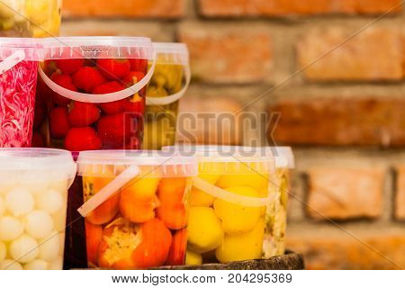 Jars With Pickled Vegetables In Cellar