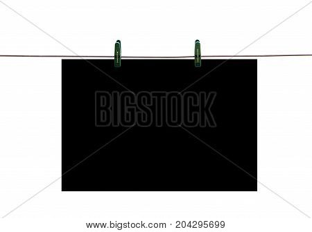 The Black Piece Of Paper Hanging On Rope With Clothespins. Closeup. Isolated On White Background