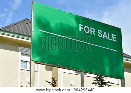 For sale sign in front of a building