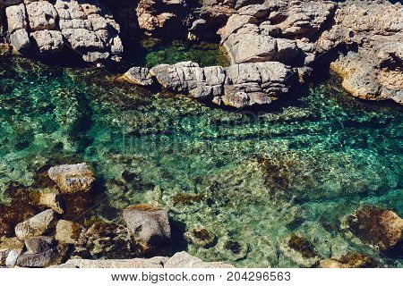 Coastline Surrounded By Stone Formations In Puerto De San Miguel Of Ibiza. Spain