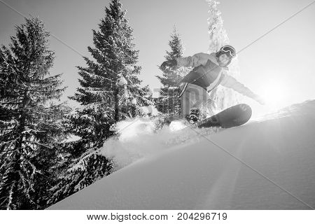 Low Angle Monochrome Shot Of A Freeride Snowboarder Riding The Slope Copyspace Extreme Winter Sports