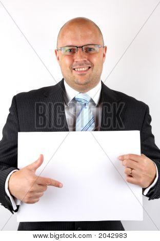 Businessman Pointing At Blank Sign