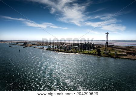 View into the entrance to the Suez Canal from the Mediterranean Sea at Port Said and Port Fouad in backlight