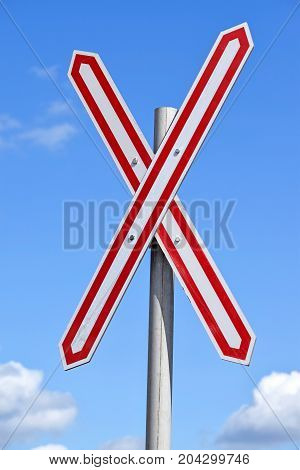 Railway crossing sign at the road crossing