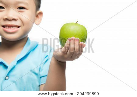 Asian baby boy holding and eating red apple isolated on white