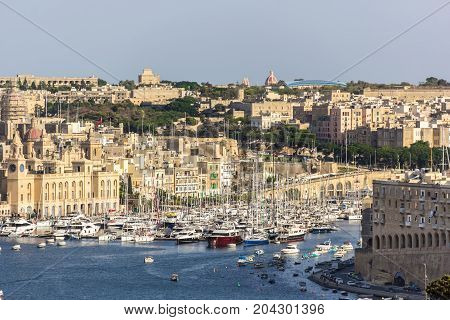 View of the bay with a large number of yachts and boats. The Republic of Malta.