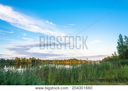 Karelian Landscape In The Rays Of The Setting Sun.