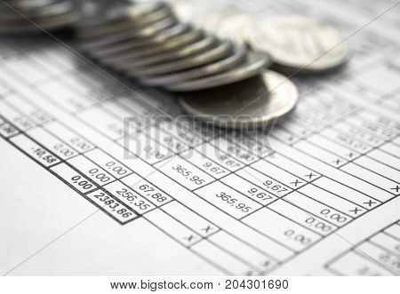 utility bill and coins for payment close up