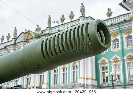 The Barrel Of An Artillery Gun In The Background Of The Winter Palace In St. Petersburg.