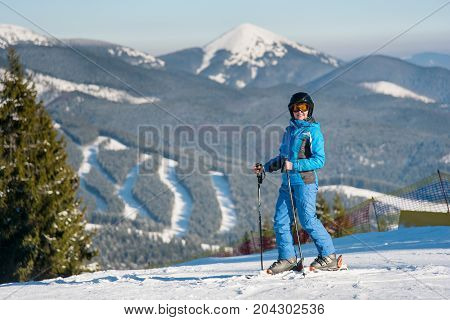 Cheerful Woman Skier Smiling Joyfully To The Camera While Skiing In The Carpathians Mountains At Win