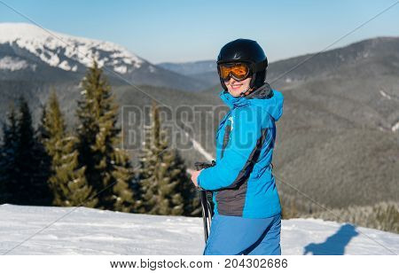 Close Up Shot Of A Female Skier Smiling To The Camera Joyfully While Skiing In The Mountain On A Sun